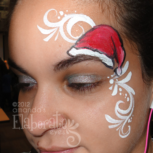 Christmas Face Paint.Winter Face Painting Elaborate Eyes Face Painting